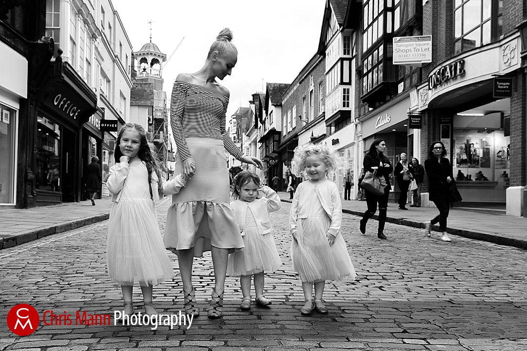 bride with flower girls walking Guildford High Street