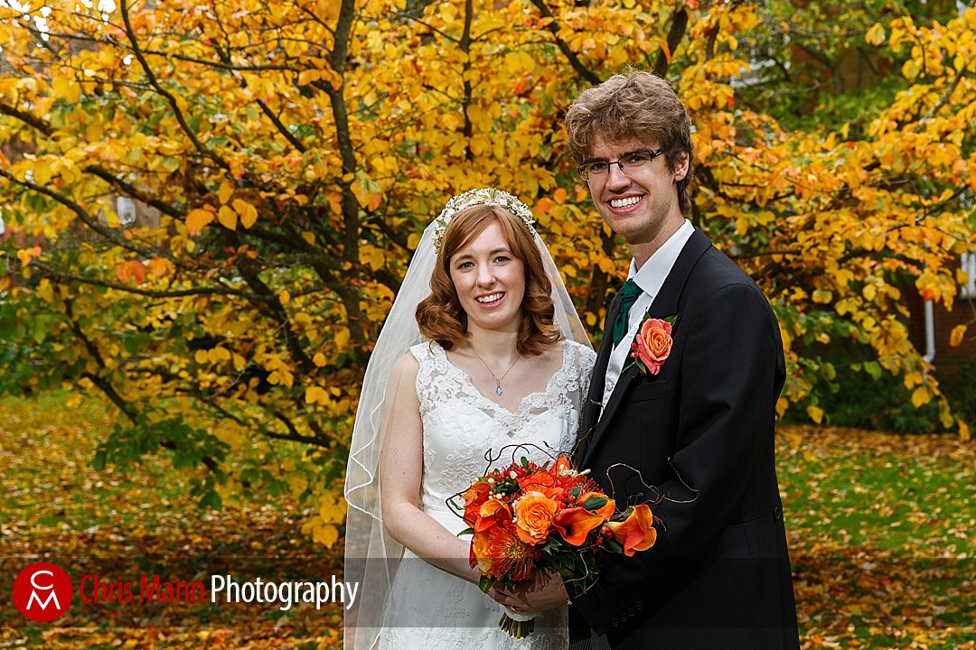 bride and groom autumn leaves fall Lady Margaret Hall Oxford