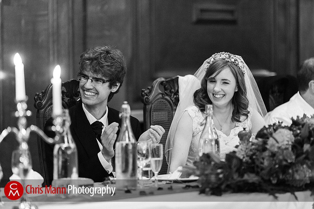 bride and groom listen to speeches Lady Margaret Hall Oxford