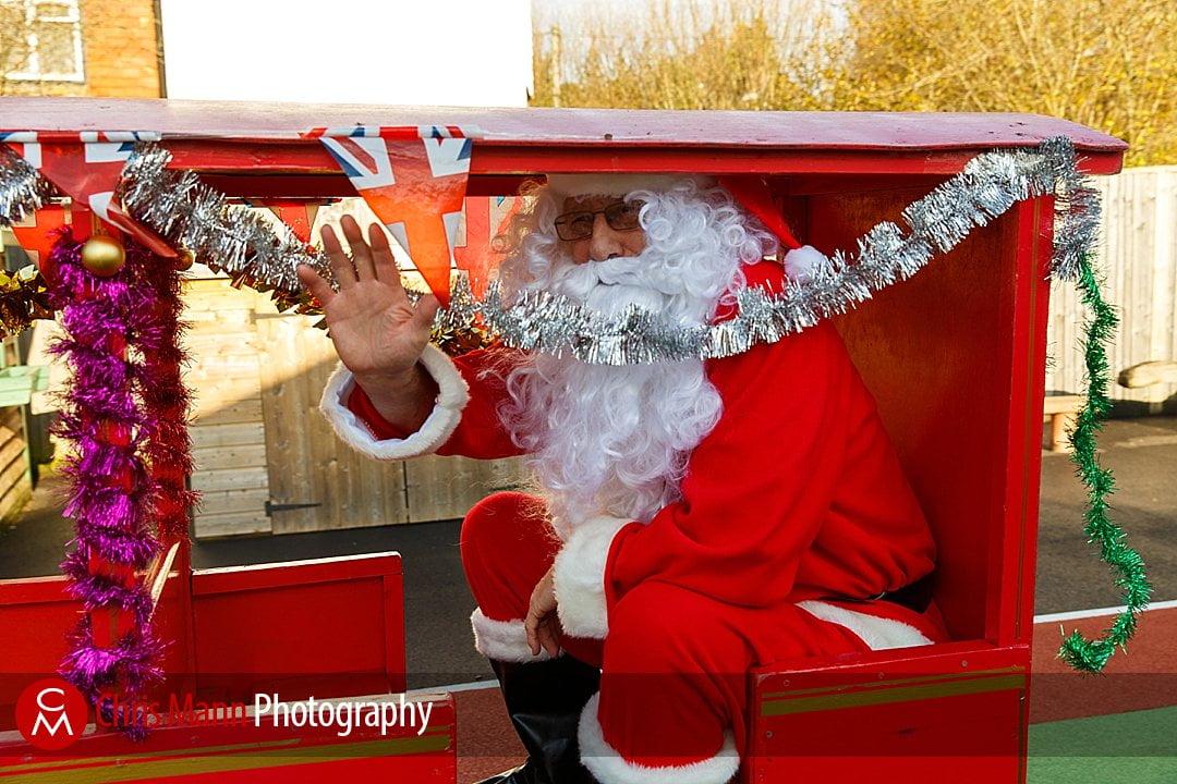 Santa waves form the train Wonersh & Shamley Green Primary School Christmas Fair photos
