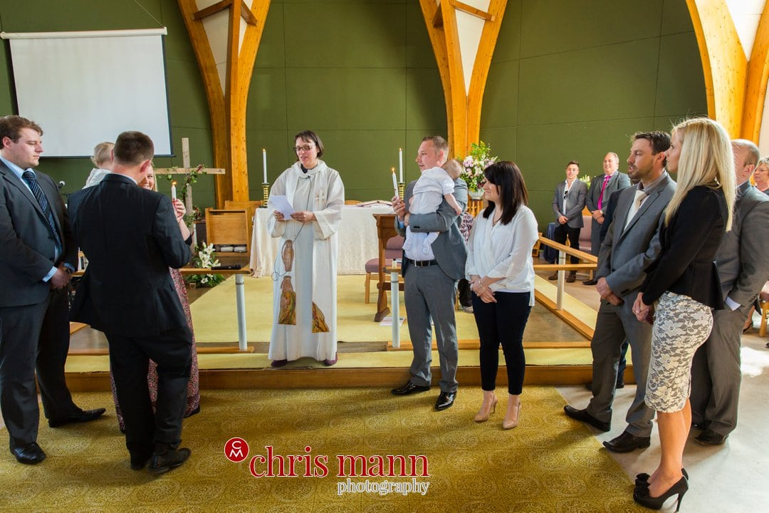 minister leads christening service