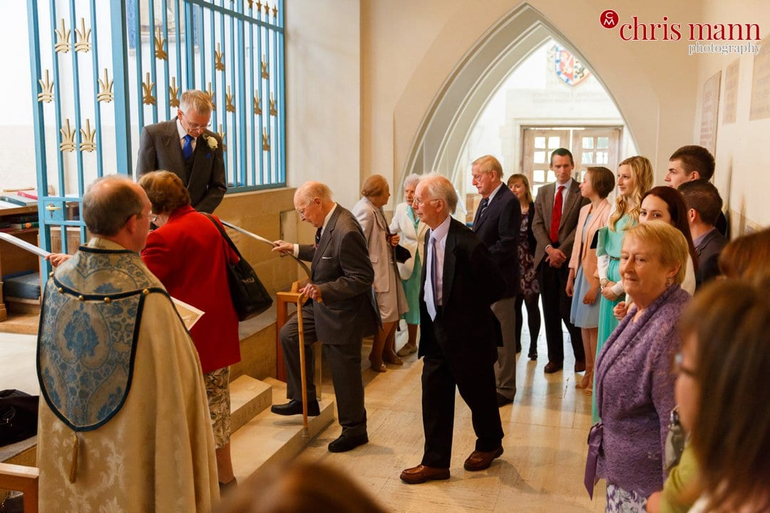 guests enter Lady Chapel Guildford Cathedral wedding