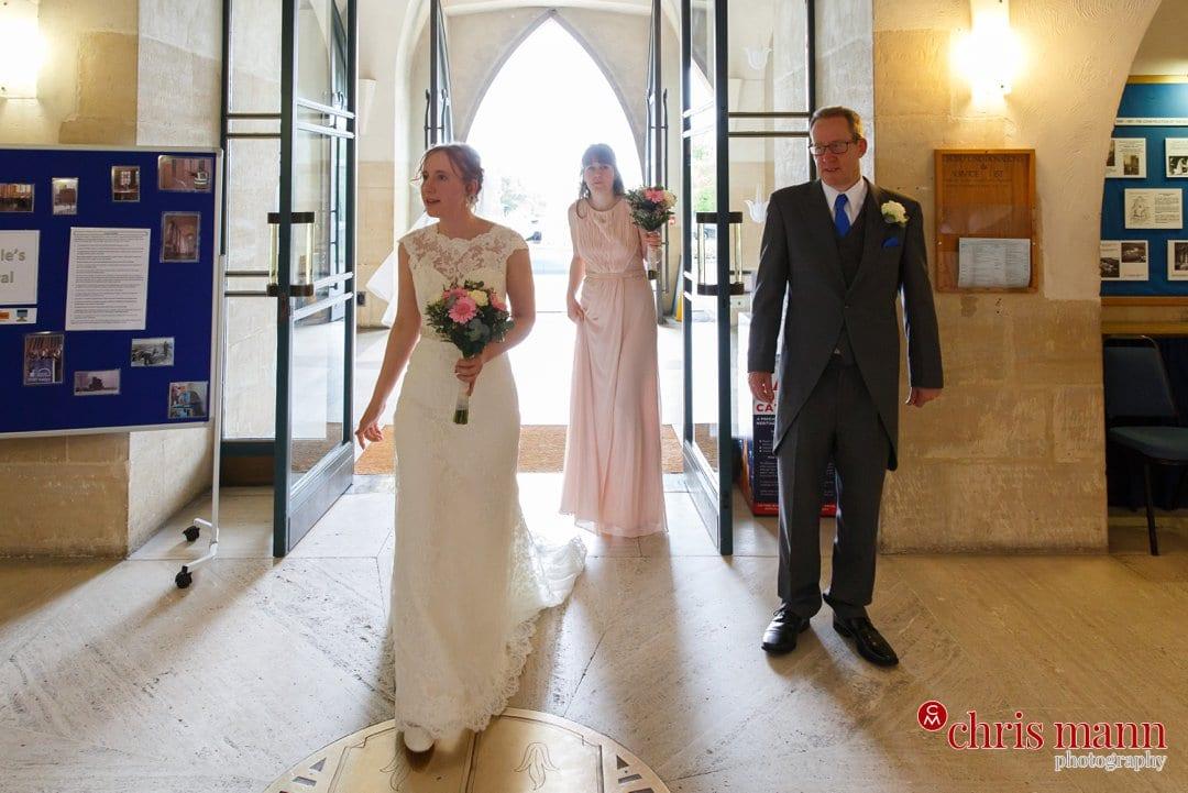bride bridesmaid father enter west door Guildford Cathedral