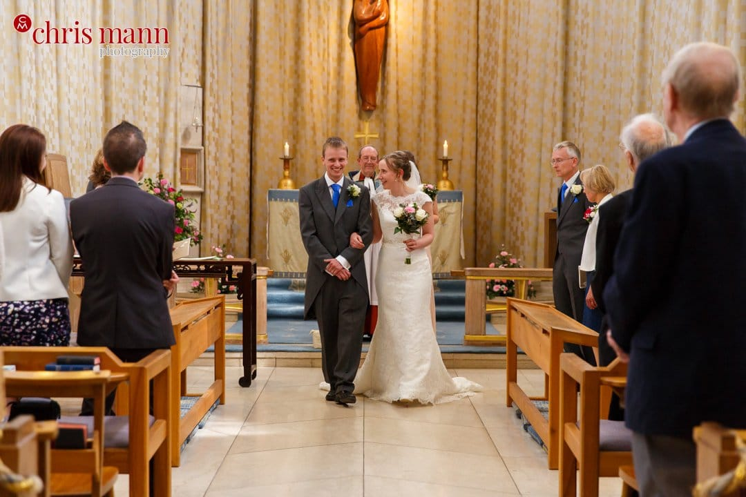 bride and groom recessional Guildford Cathedral Lady Chapel