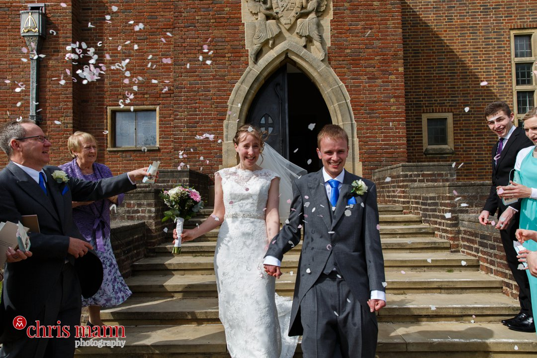 bride and groom confetti toss south door Guildford Cathedral