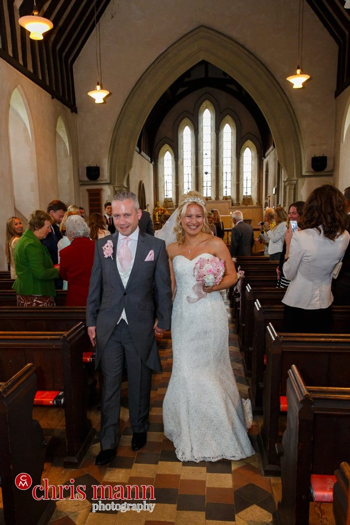 bride and groom recessional t Luke's Church Burpham Guildford Surrey