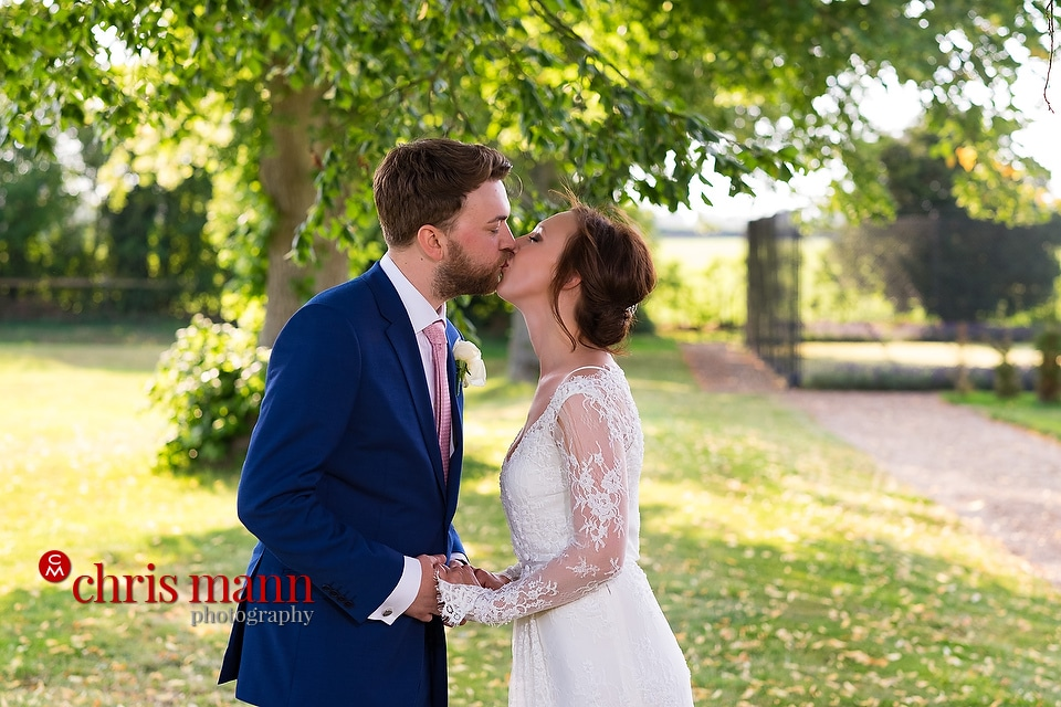 Cotswolds country wedding bride and groom kiss on summer's day
