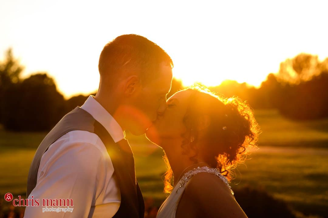 sunset photo bride and groom kiss Surrey Downs Golf Club
