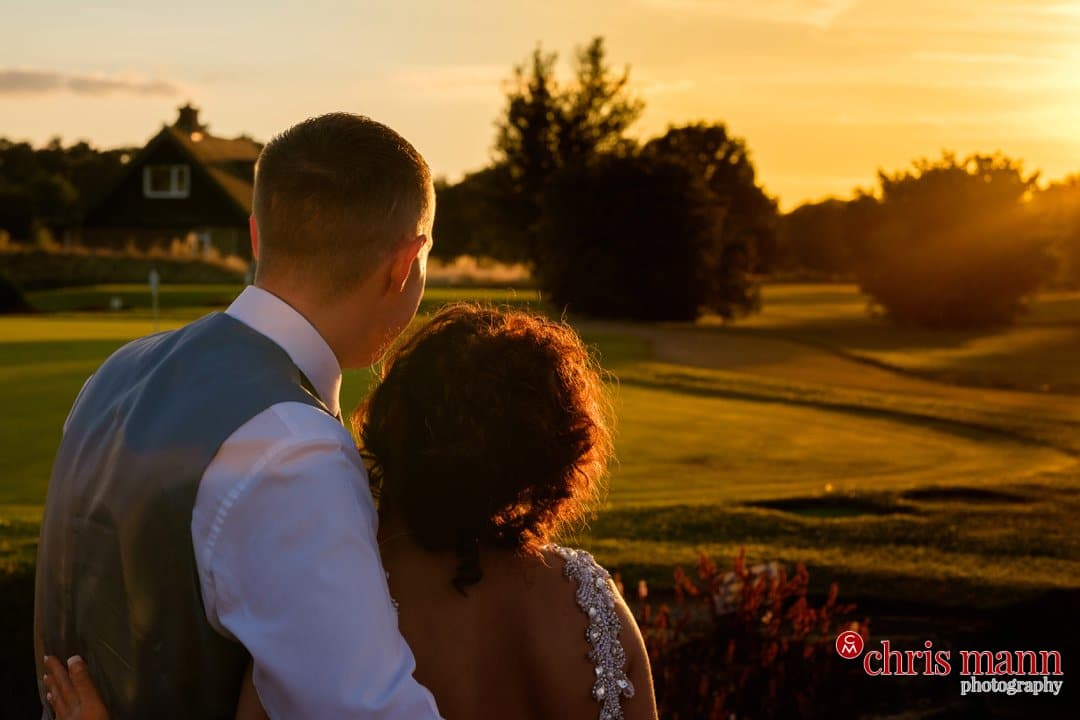 sunset photo bride and groom looking at sunset Surrey Downs Golf Club