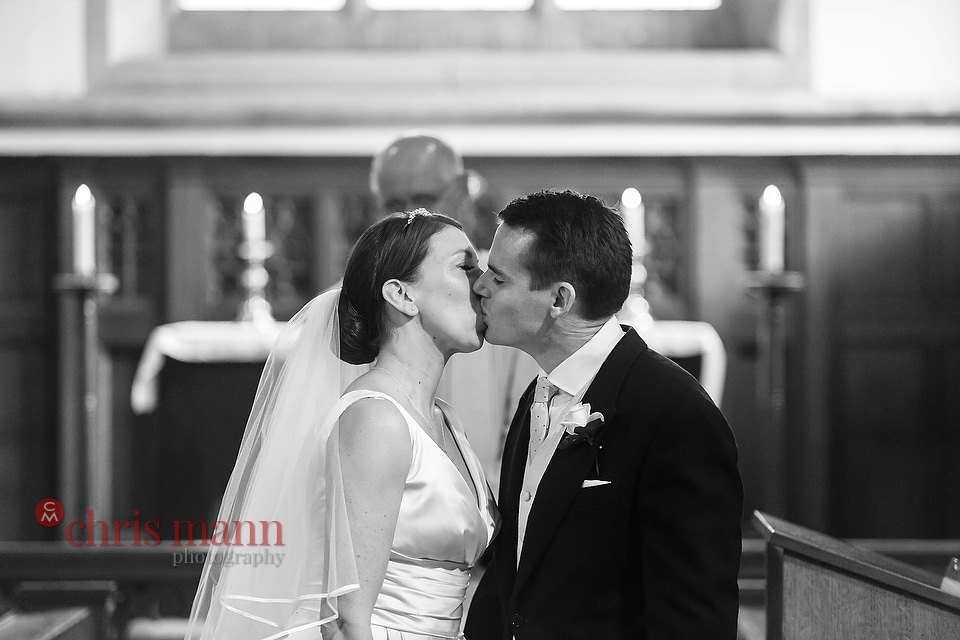 Hampshire wedding photos bride and groom first kiss