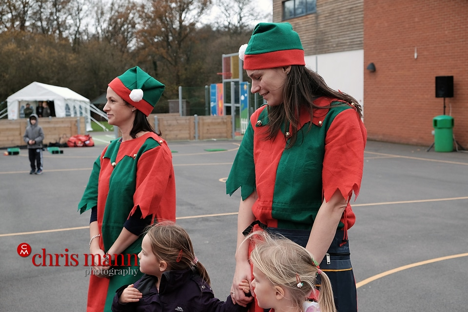 Santa's elves help to entertain children Wonersh and Shamley Green Primary School Xmas Fair 2015