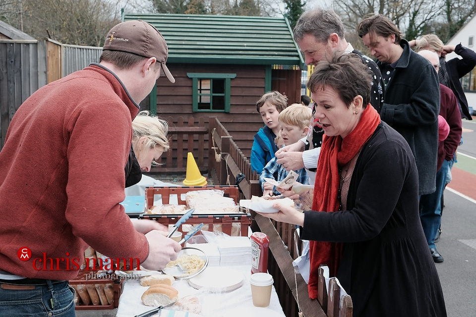 visitors enjoying hotdogs Wonersh and Shamley Green Primary School Xmas Fair 2015