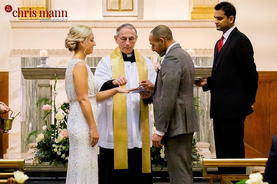 couple exchange rings catholic wedding ceremony Wimbledon
