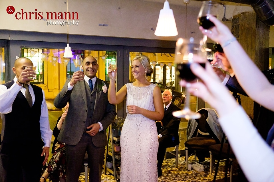toast happy couple wedding reception Aubaine restaurant Wimbledon