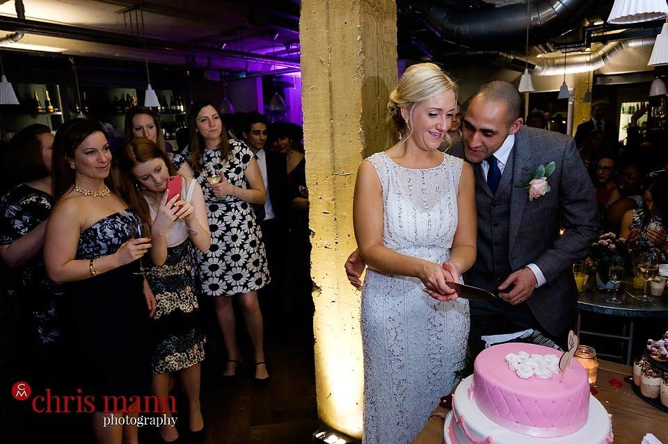 cake cutting bride and groom Aubaine restaurant Wimbledon