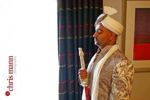 Asian groom preparing for wedding