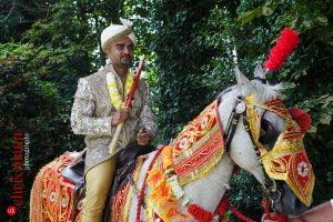 Indian groom arrives at wedding on horseback