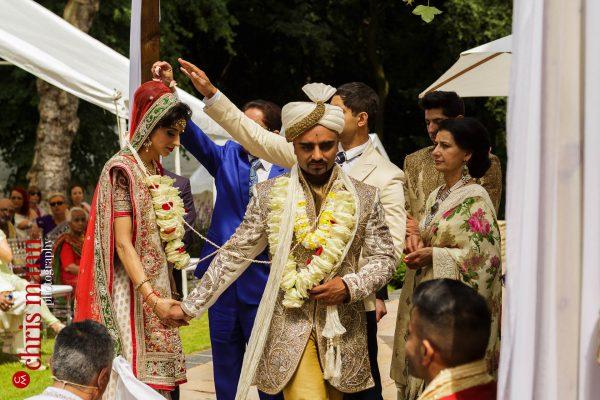 Asian wedding Cheshire Hundu ceremony couple walk around fire