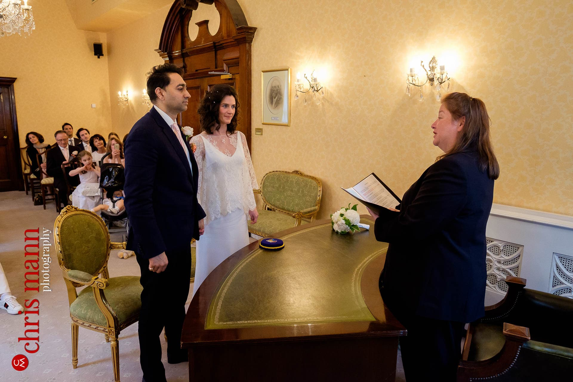 Chelsea Registry Office wedding - couple with officiant