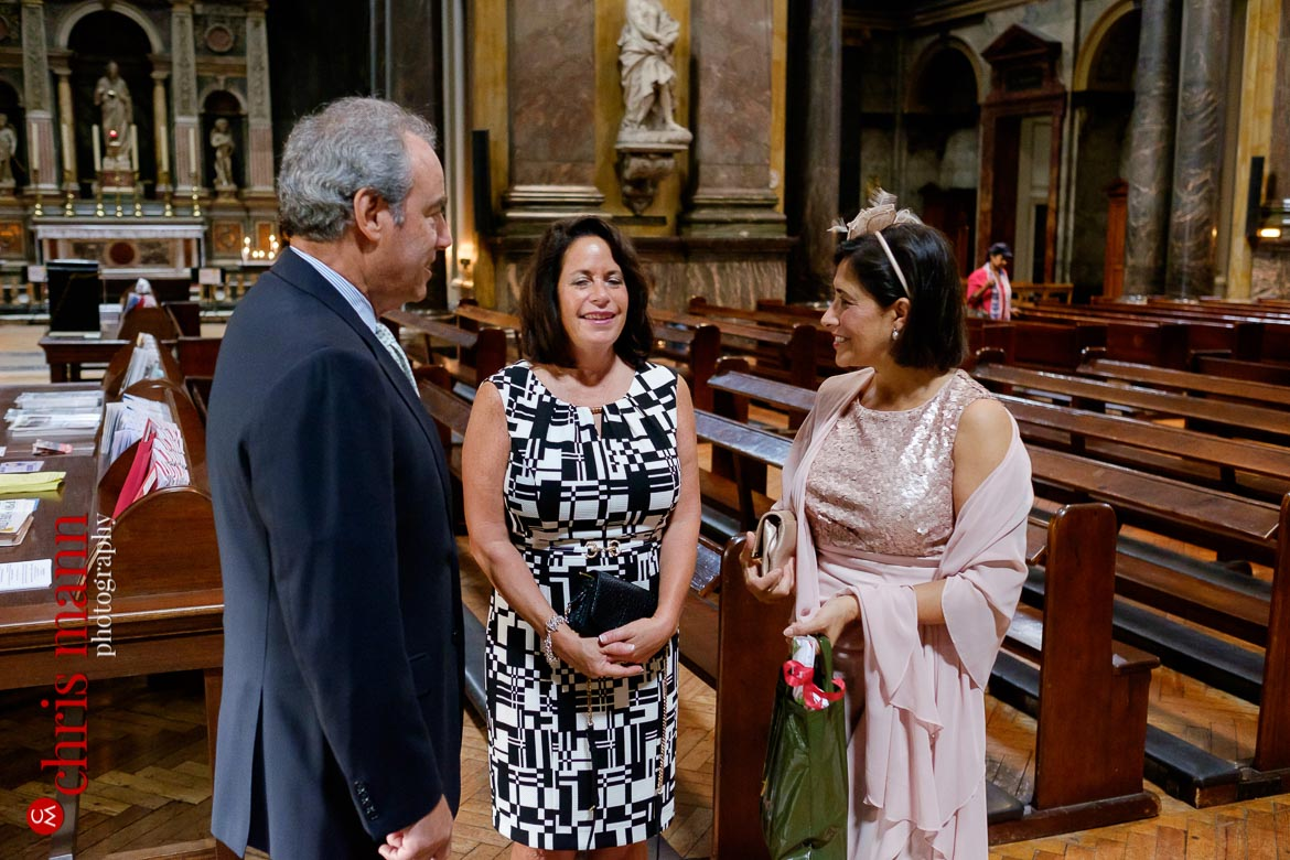 guests chatting before christening service at Brompton Oratory Knightsbridge London