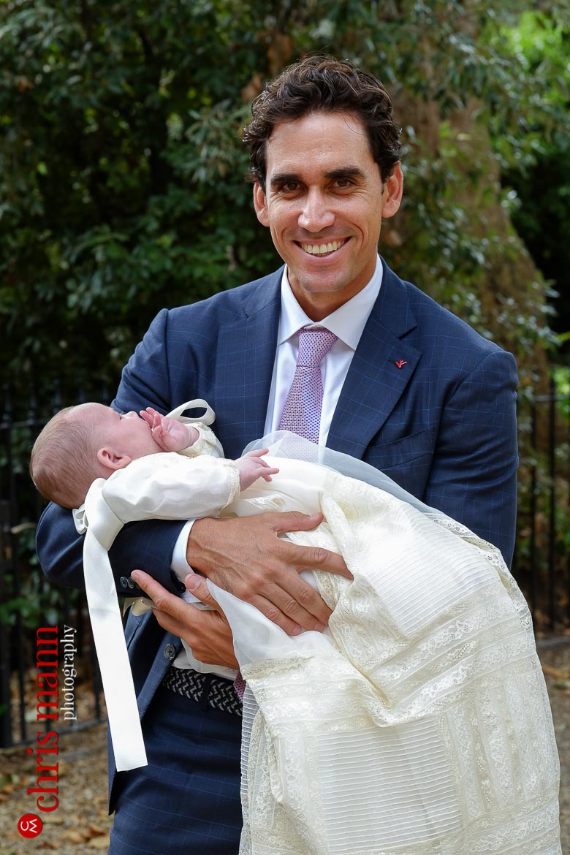godfather holding goddaughter at Brompton Oratory Knightsbridge London