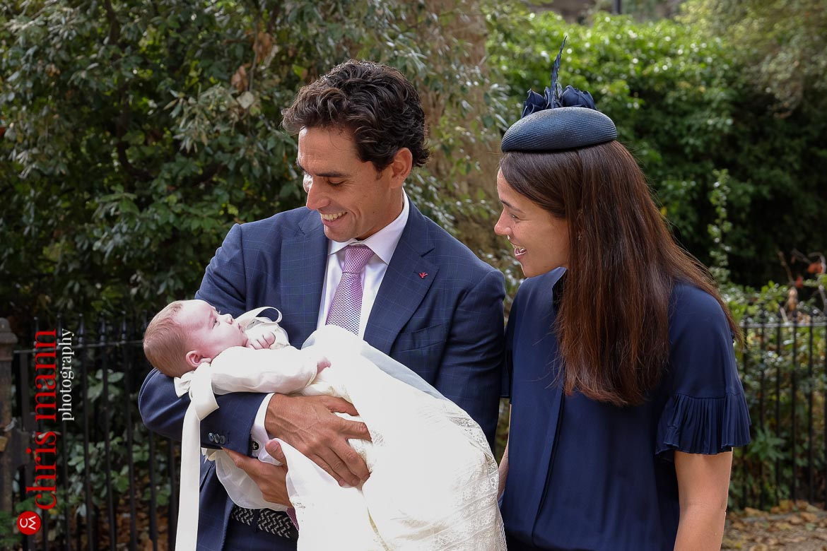godparents holding baby at christening Brompton Oratory Knightsbridge London