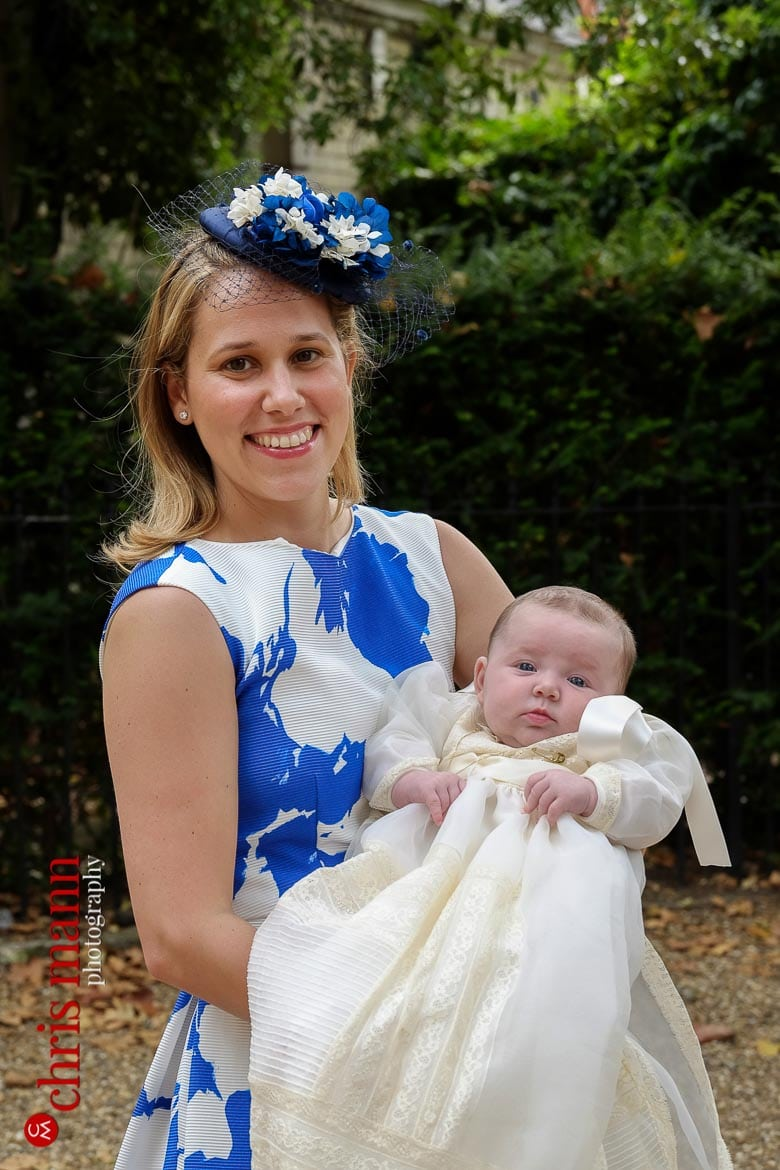 proud mother holdys baby before christening ceremony at Brompton Oratory Knightsbridge London