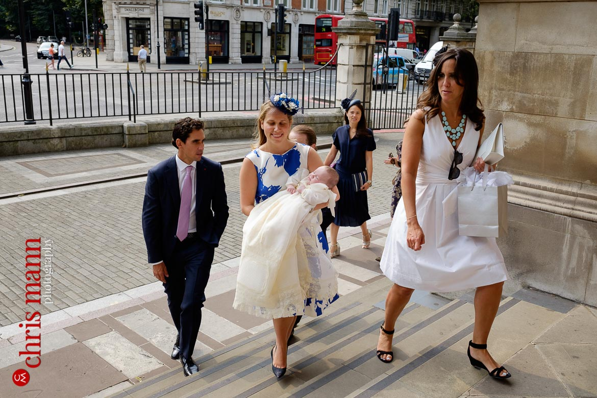 Brompton Oratory christening photos parents and child arrive