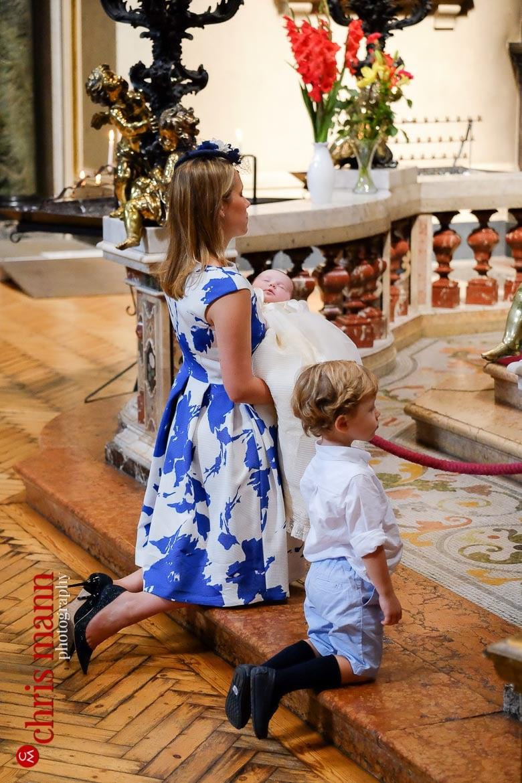 mother and children kneel in prayer Lady Chapel Brompton Oratory Knightsbridge London