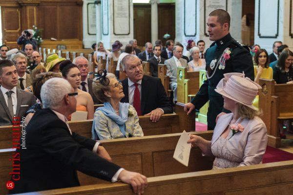 groom greets family at wedding in Royal Memorial Chapel Sandhurst