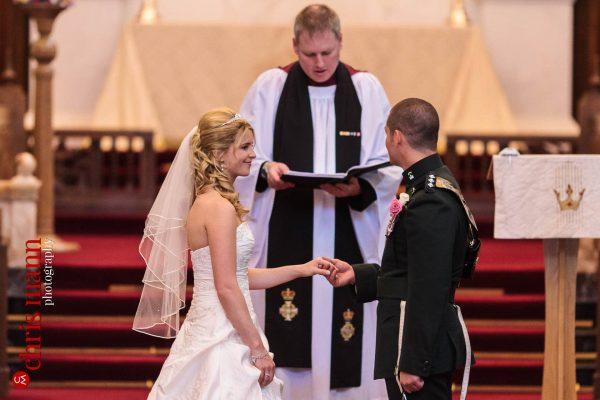 brdie and groom hold hands Royal Memorial Chapel Sandhurst