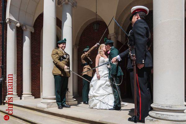 guard of honour bride and groom kiss wedding Royal Memorial Chapel Sandhurst