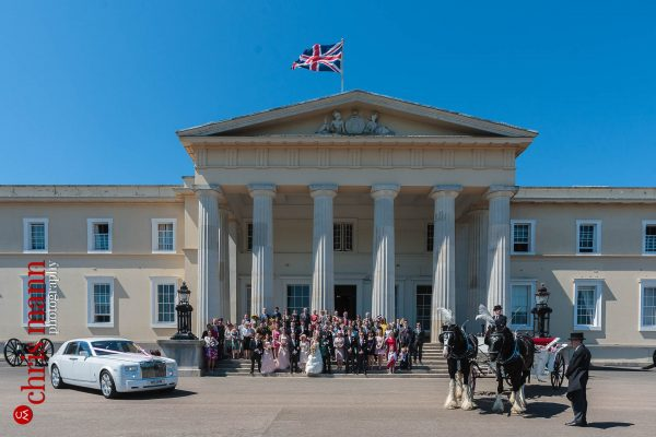 wedding group photo outside Royal Military Academy Sandhurst