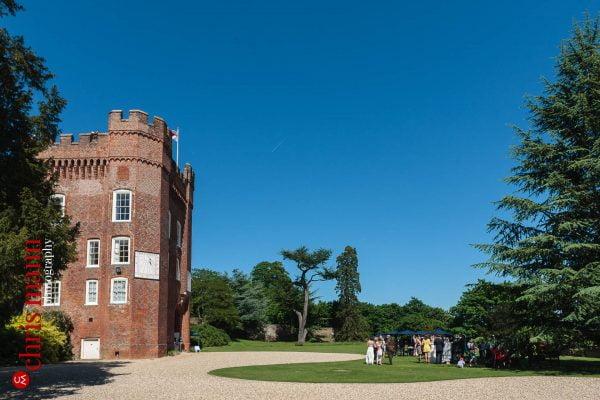 wedding guests on lawn Farnham Castle
