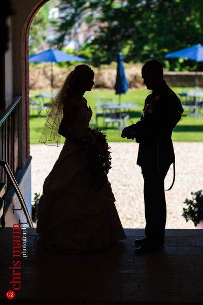 bride and groom silhouette Farnham Castle