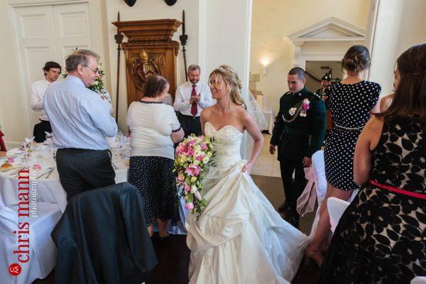 bride and groom enter wedding reception Farnham Castle Great Hall