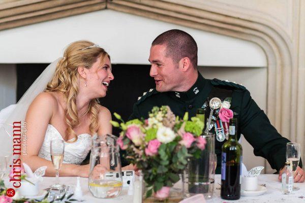 happy bride and groom wedding reception Farnham Castle Great Hall