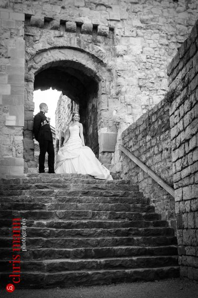 bride and groom portrait on steps of the Keep Farnham Castle