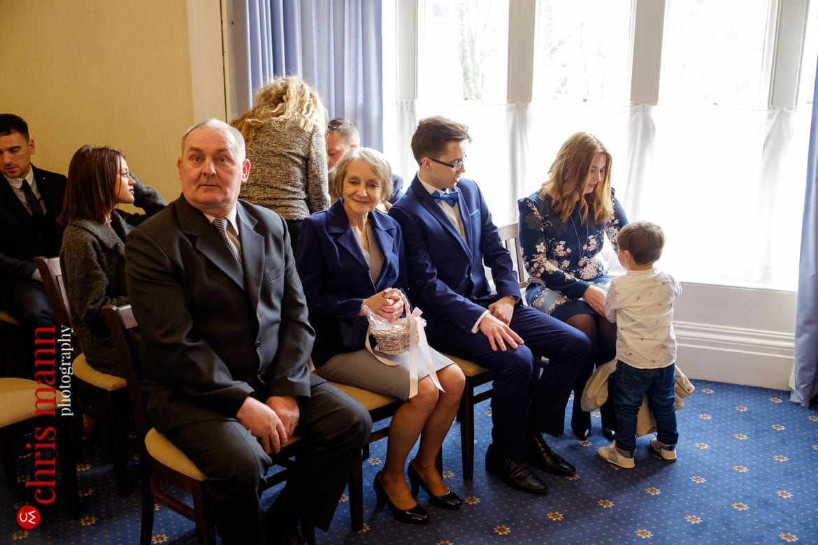 family and friends await wedding ceremony Artington House Guildford register office