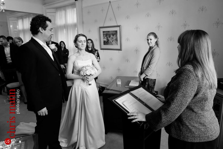 bride and groom with registrar Artington House Guildford Wedding