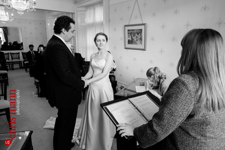 bride and groom holding hands Artington House Guildford register office