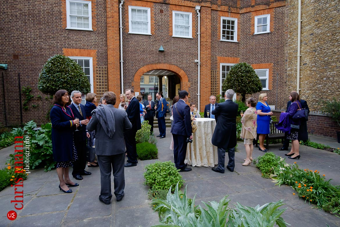 guests mingle at reception in Cloister Garden Museum of the Order of St. John Wedding Clerkenwell London