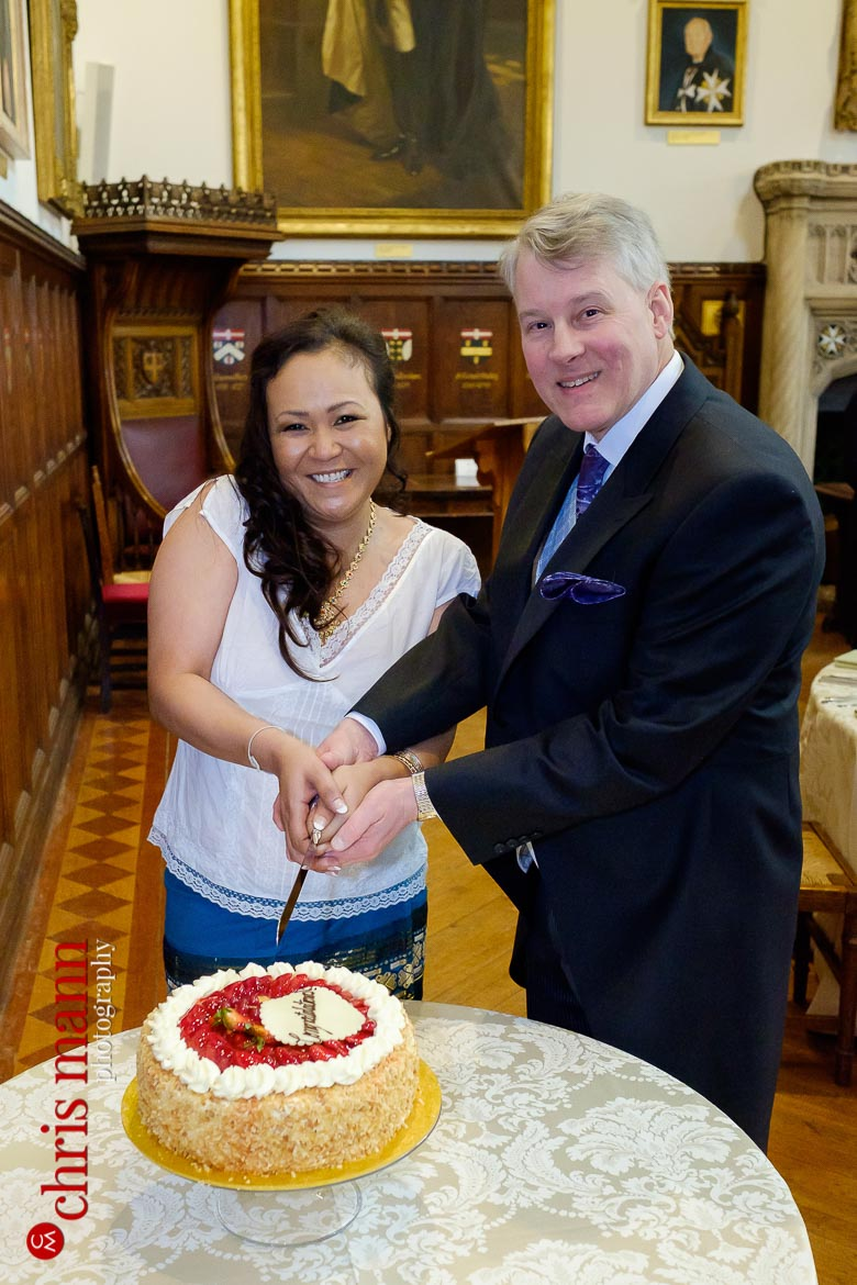 bride and groom cake cutting Chapter Hall Museum of the Order of St. John Wedding Clerkenwell London