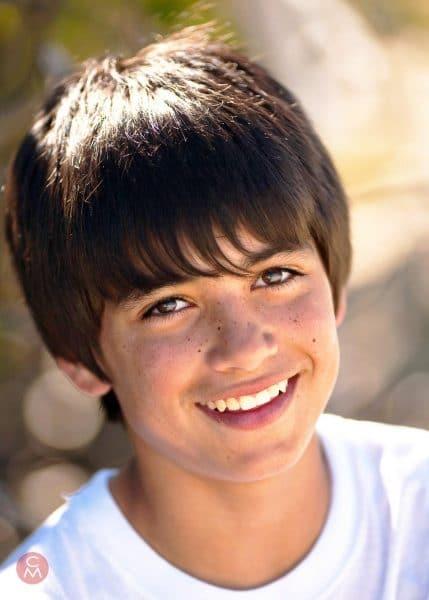head and shoulders portrait smiling boy portrait photography Chris Mann