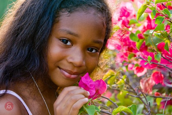 young girl with bougainvillea aflowers portrait photography Chris Mann