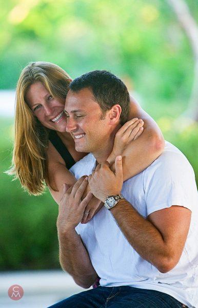 laughing couple woman embraces man portrait photography Chris Mann