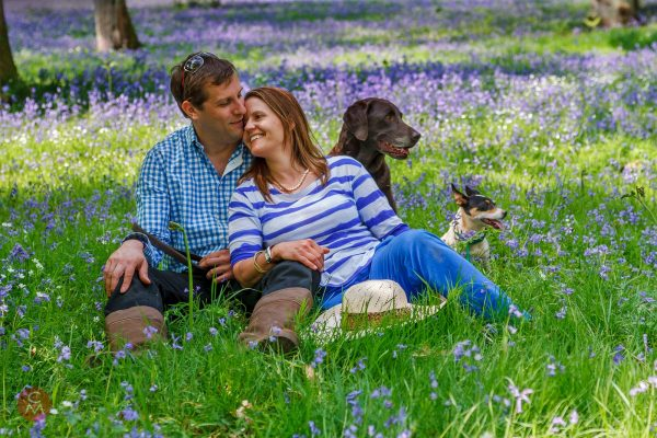 couple with dogs bluebell wod portrait photography Chris Mann