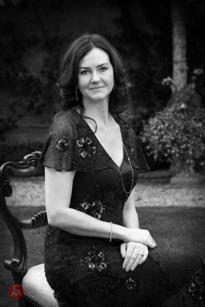 woman poses formal portrait photography Chris Mann