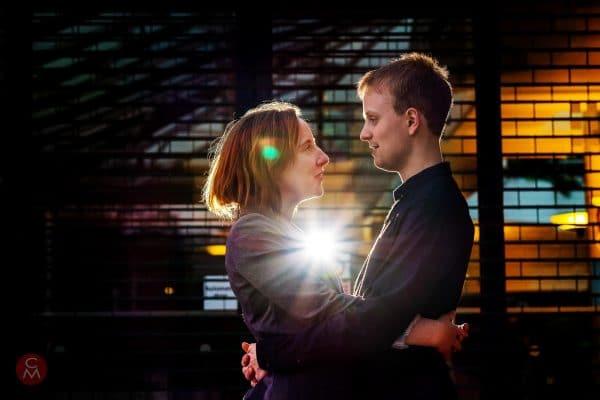 engagement shoot couple facing each other backlit portrait photography Chris Mann