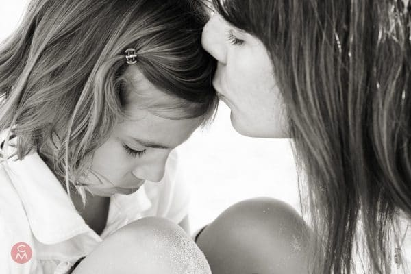 mother kisses daughter portrait photography Chris Mann